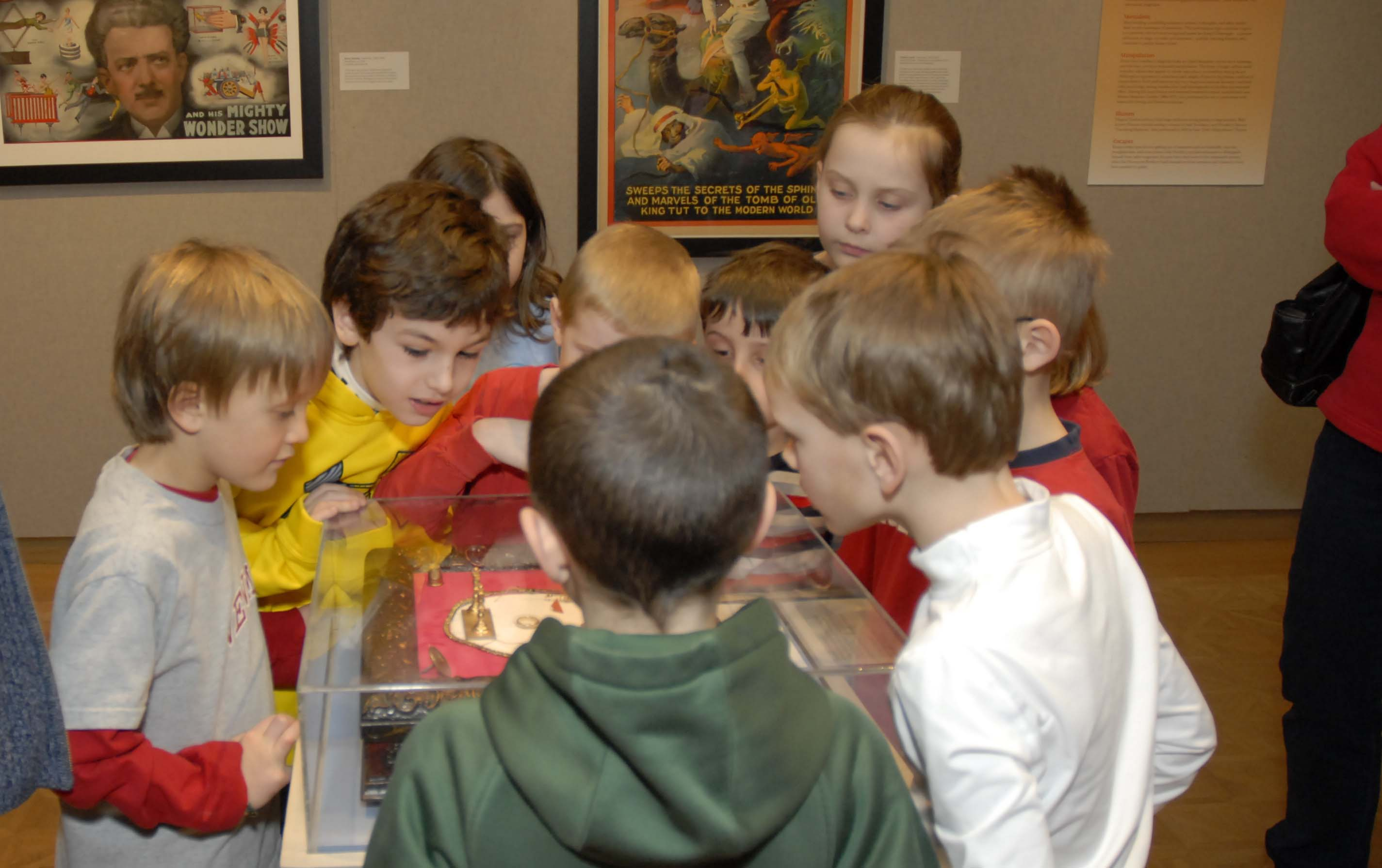 Children look at a flea circus display during the Mystery, Magic, & Mayhem exhibitions.
