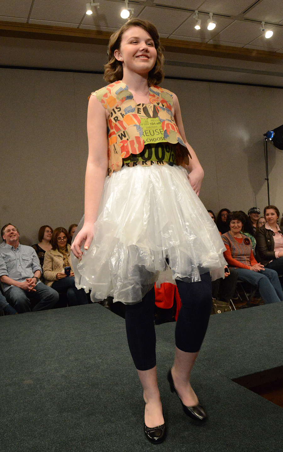 A volunteer models an upcycled garment.