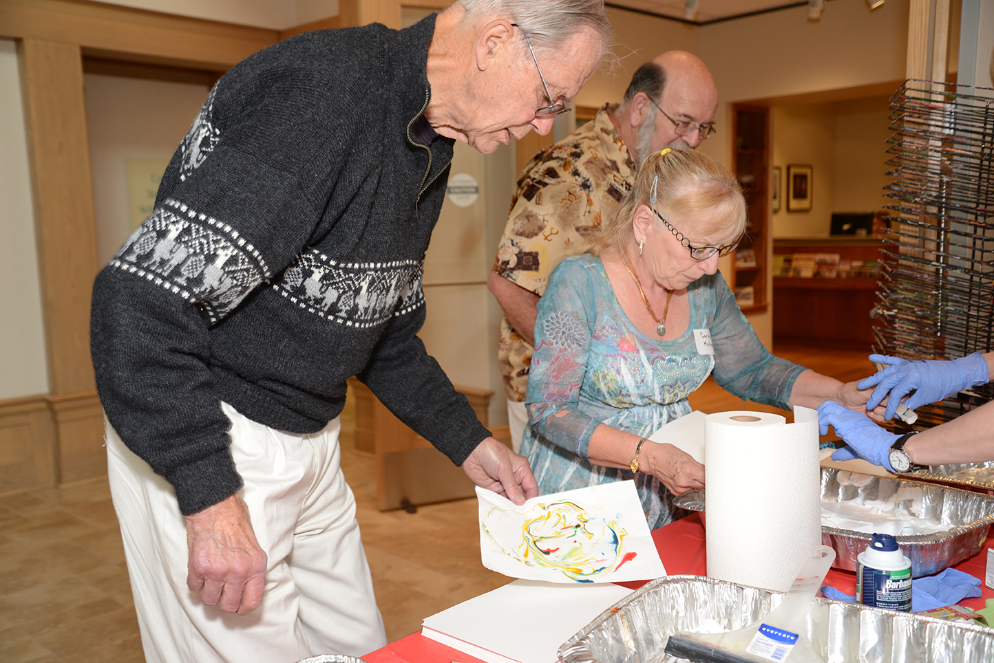 Adults review results of shaving cream printmaking