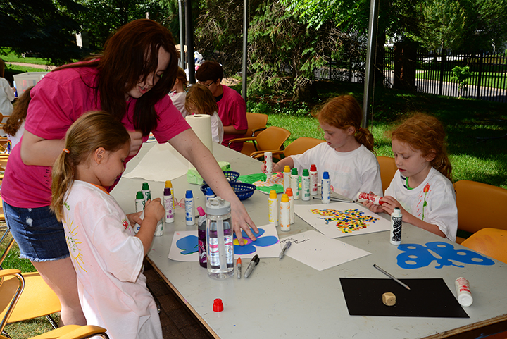 Summer art campers creating art at the Woodson Art Museum