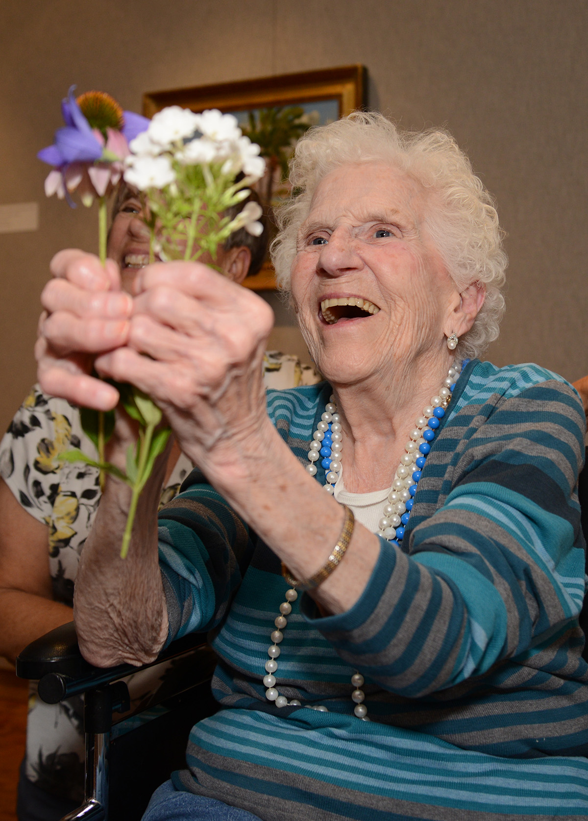SPARK! participant enjoys flowers in Woodson Art Museum gallery