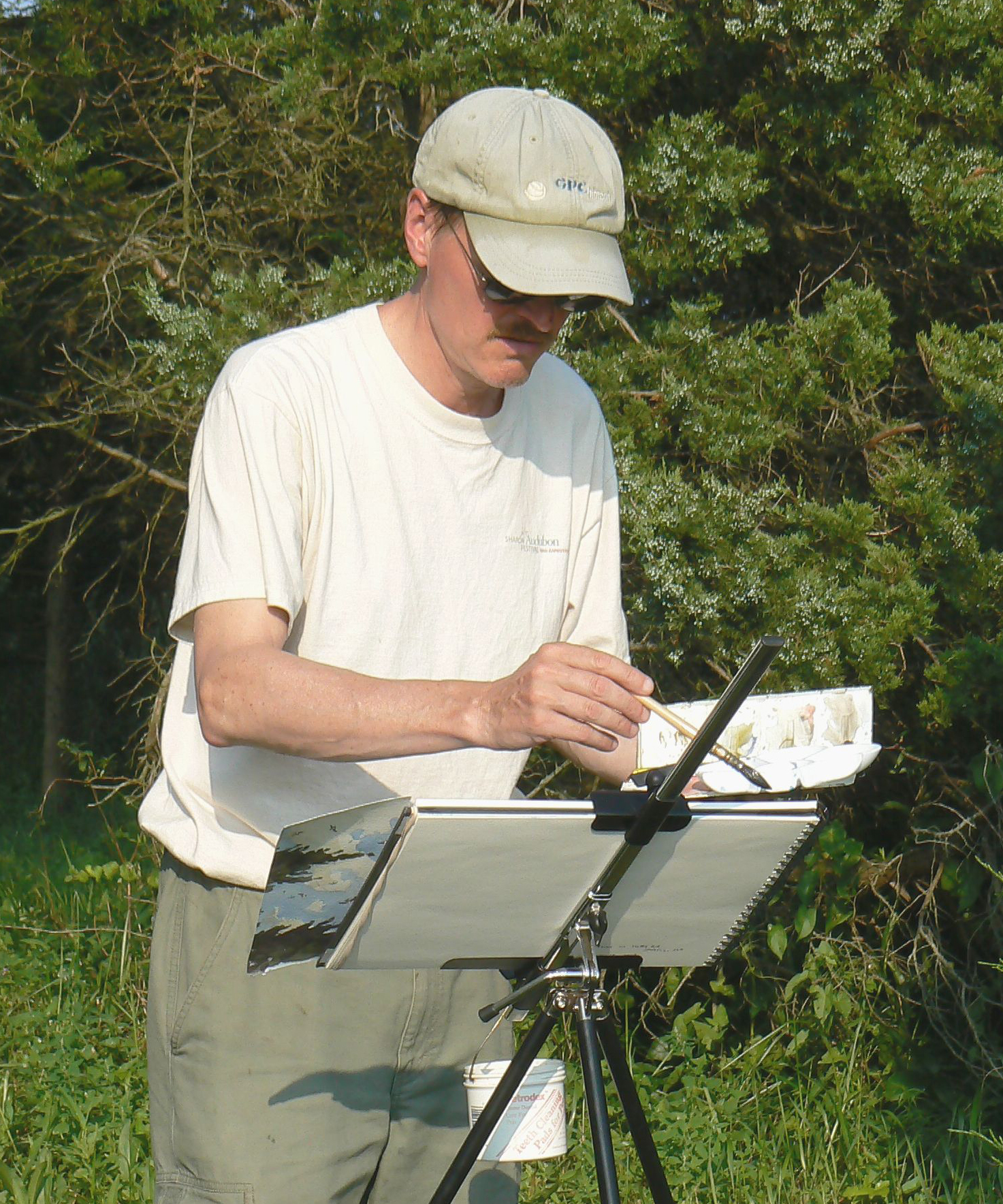 Barry Van Dusen painting in the field