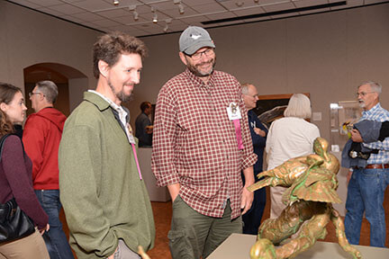 Sean Murtha (left) and former museum professional Paul Rhymer (right) discussing Paul's work at the public opening of Birds in Art.